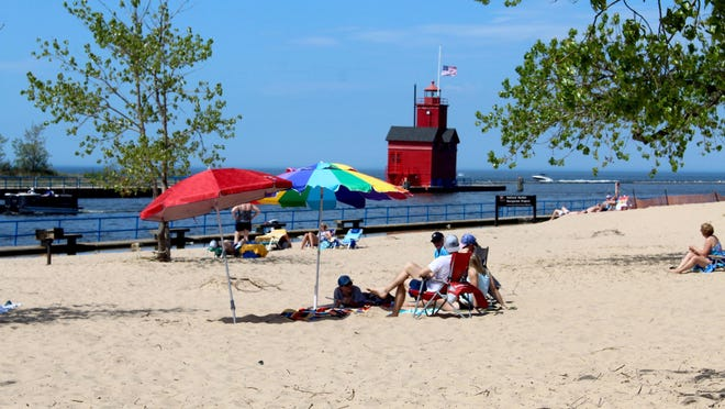 Beachgoers enjoy Holland State Park on Memorial Day 2020. The park is now seeking bids for concession providers, due Tuesday, Dec. 22.