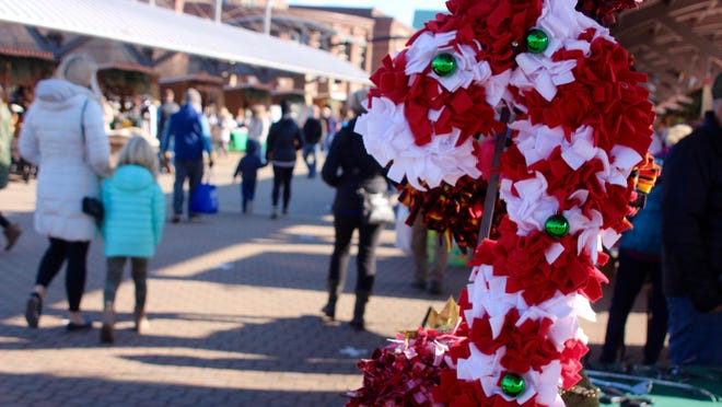 Holiday shoppers flocked Saturday, Nov. 21, to the 8th Street Marketplace for the opening day of Kerstmarkt's 2020 season.