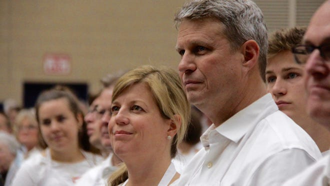 U.S. Rep. Bill Huizenga, R-Zeeland, and his wife, Natalie, listen to Holland Mayor Nathan Bocks address the crowd on Wednesday, Nov. 27, 2019 at the Holland Rescue Mission's Great Thanksgiving Banquet at DeVos Fieldhouse. Huizenga, who maintained he still had issue with the way absentee ballot applications were distributed in Michigan, said he will not contest Michigan's election results.