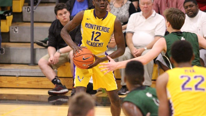 Marquez Lechter-Ellis looks for someone to pass to during Montverde's victory over Trinity.
