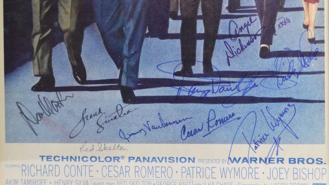 """A signed poster from the """"Ocean's Eleven"""" movie goes to auction soon."""