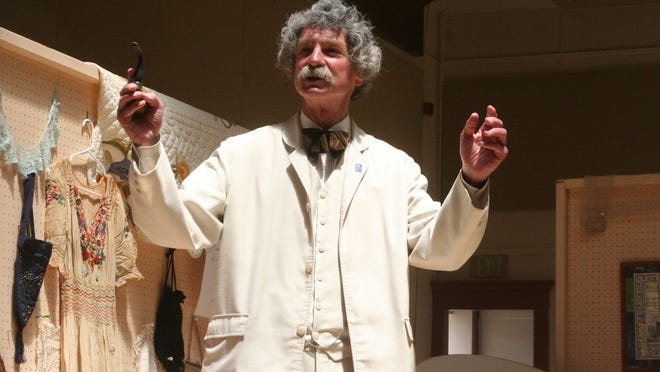 """MacAvoy Lane performs as Mark Twain at the Dayton Community Center during the """"Discover Gold in Old Town Dayton Again"""" celebration."""