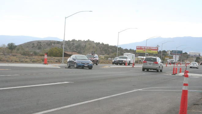Traffic flows on U.S. 50 through Mound House at the intersection of Nevada 341, where a T intersection was installed. Paving on the project is scheduled to be completed this week.