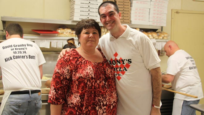 Kelley and David Granby in the kitchen of Krony's Pizza Etc. in Hamlin during an Oct. 20 fundraiser for David, who was recently diagnosed with brain cancer.