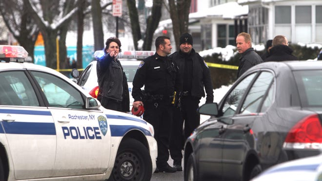 File photo: Rochester police investigate a shooting on Maple Street.