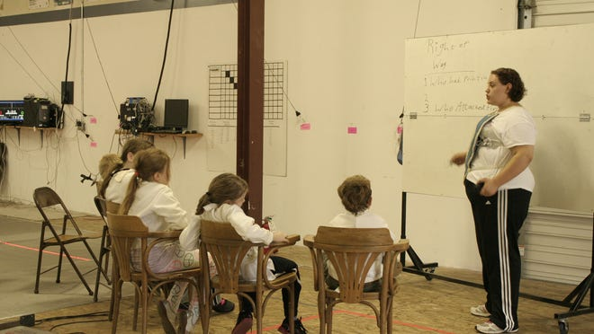 Teacher Mary Keatley teaches theory during the Musketeers Class at Salem Fencing Club on August 21.
