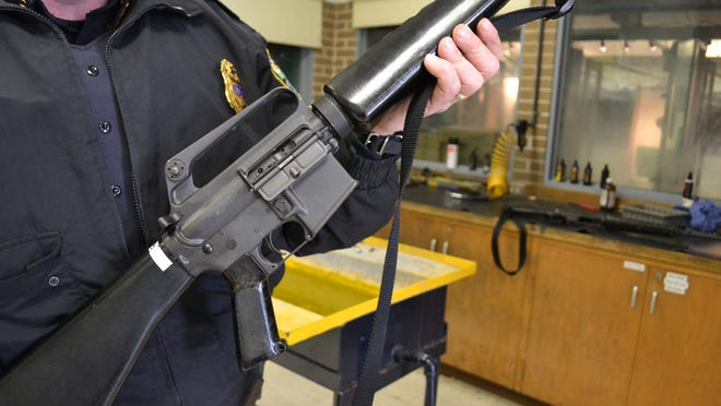 A Colt M-16 rifle, similar to the one shown Tuesday at the Shreveport Police Department's armory, was stolen from inside an officer's vehicle in January.