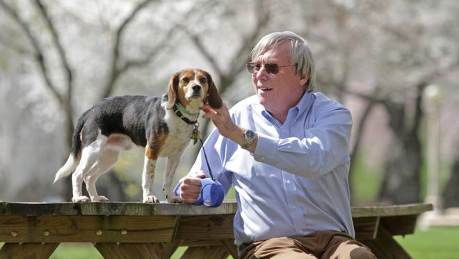 Joseph P. Connor Jr., 62, of Wilmington, plays with his 4-year-old dog he calls Dax the Beagle, who keeps him company when he's not out helping other people recover from addiction.