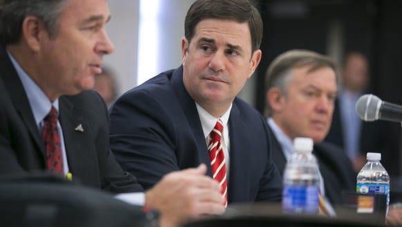 Mark Killian, (left) chair of the Arizona Board of