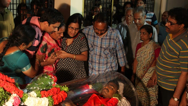 Relatives grief around the body of Srinivas Kuchibhotla after the body was flown from the U.S. to his residence on the outskirts of Hyderabad, India, Tuesday, Feb. 28, 2017.