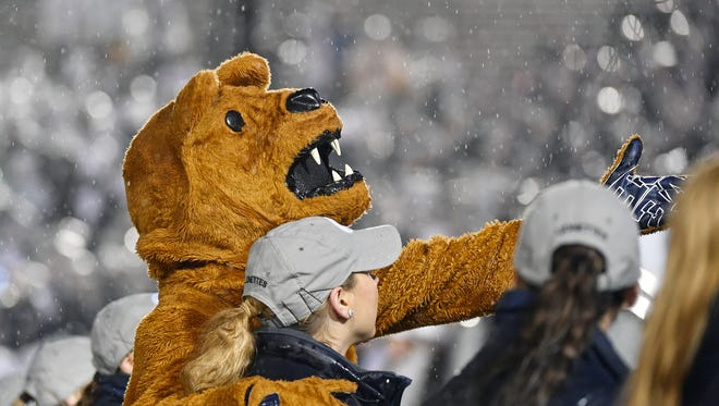 The Nittany Lion mascot stands among the cheerleaders in the south end zone during the second half of an NCAA Division I football game Saturday, Nov. 18, 2017, at Beaver Stadium. Penn State defeated Nebraska 56-44 in its final home game of the 2017 season.