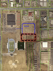 The potential dog park behind the West Allis Police Station is being envisioned (outlined in red) south of the soccer fields (outlined in blue) that the West Allis-West Milwaukee School District wants to eventually build. Nathan Hale High School is just west of the site and dog-lovers are hopeful that some kind of arrangement can be made for dog park users to share the school parking lot.