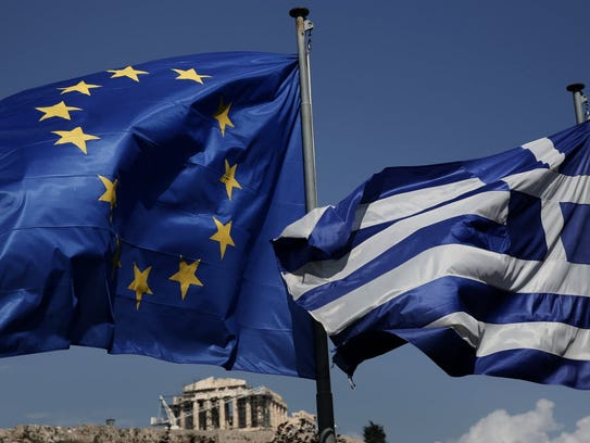 An EU and a Greek flag fly in front of the ancient