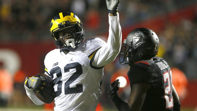Michigan Wolverines wide receiver Amara Darboh (82) reacts after making a catch against Rutgers Scarlet Knights defensive back Ross Douglas (21) for a first down  during first half at High Point Solution Stadium,Piscataway,NJ. Saturday, October 8, 2016. Noah K. Murray-Correspondent/Asbury Park Press Michigan vs. Rutgers football