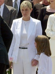 Jill Kelly holds the hand of her daughter, Camryn, 6, during Hunter's funeral service on Aug. 9, 2005.