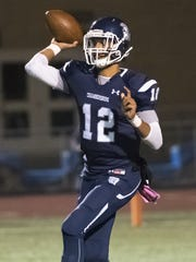 Trojan's quarterback Tyler Collier (12) throws the ball during a football game on Friday, Oct. 28, 2016 at Trojan Stadium in Chambersburg, Pa.