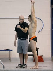 RIT diving coach Cliff Devries works with Alex Dieroff