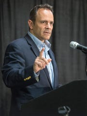 Kentucky Gov.-elect Matt Bevin makes his closing remarks at the Republican State Central Committee Meeting at the Triple Crown Pavilion conference center in Louisville.