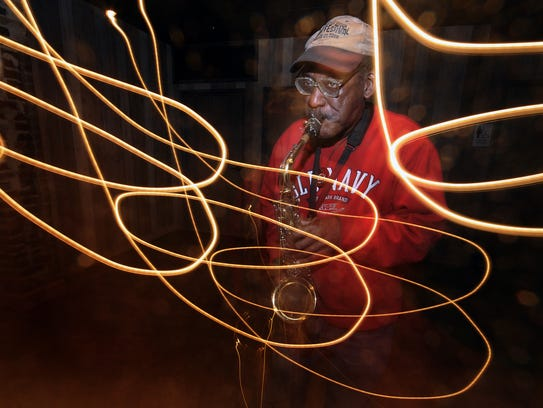 Veteran Wilmington jazz saxophonist Harry E. Spencer Jr. warms up at Nomad Bar in Wilmington in 2010. He died May 12 at the age of 78.