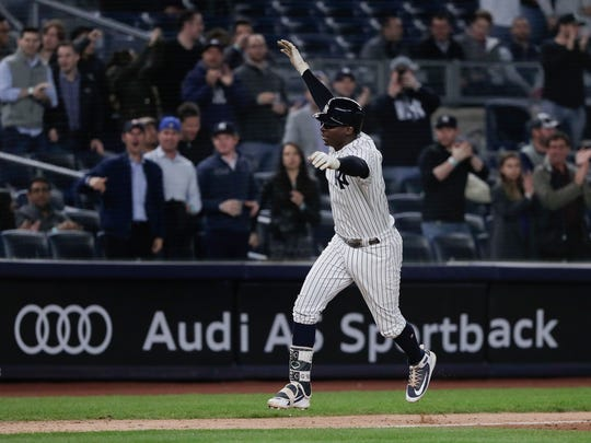 New York Yankees' Didi Gregorius gestures as he rounds third base after hitting a two-run home run against the Minnesota Twins during the fifth inning of a baseball game Tuesday, April 24, 2018, in New York.