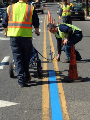 Little Falls DPW workers painting blue lines in October.