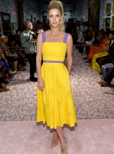 Hilton wore a bright pop of yellow to the same show.