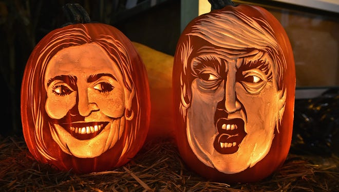 Master Carver Hugh McMahon Creates Giant Donald Trump And Hillary Clinton Pumpkin at Chelsea Market on Oct. 28, 2016 in New York City.