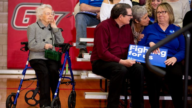Ruline Steininger of Pleasant Hill, Iowa, left, listens as Hillary Clinton speaks at a rally at Grand View University in Des Moines on Jan. 29, 2016.
