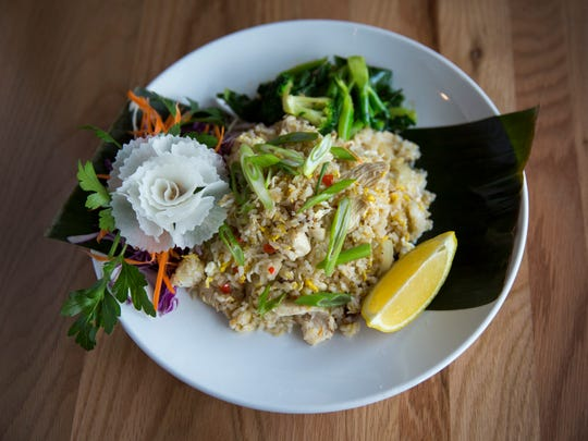 The new Buddha Barn in Sayler Park serves up Anchovy Fried Rice. It's served with jasmine rice and your choice of protein, egg, anchovies, onion, garlic, along with stir fried Chinese broccoli and Thai hot pepper in oyster sauce. The new Thai restaurant opened a couple months ago and is owned by chef Niruti Puakkawe, who goes by  Jack.