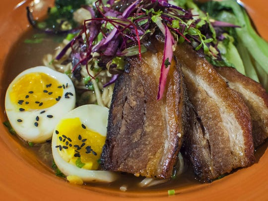 Pork belly ramen bowl with a six-minute egg, cabbage