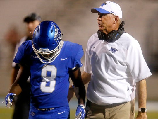 MTSU's head football Coach Rick Stockstill talks with