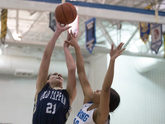 Old Tappan's Alexandra George goes up with a shot in