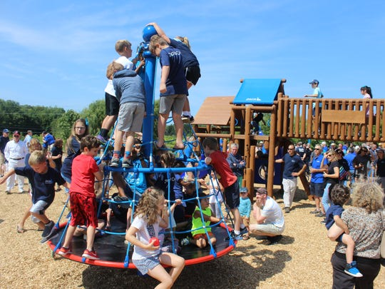 After the Jack's Place opening ceremonies concluded, children swarmed the playground, trying out all of its slides, swings, bouncing and climbing equipment.