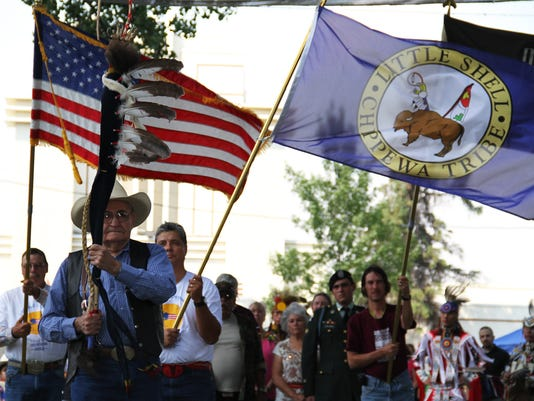 636173955139522118-ribal-war-veterans-carry-flags-during-the-opening-ceremony-of-the-Little-Shell-Chippewa-powwow.jpg
