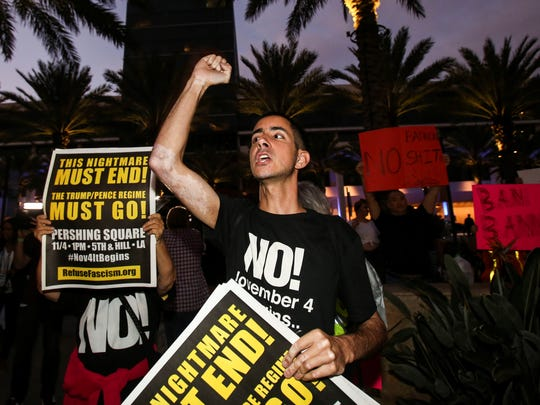 Nicholas Maldonado, 23, of San Pedro, protests outside of California Republican Convention in Anaheim, Calf., on Friday Oct. 20, 2017. Protesters have gathered outside a Southern California hotel where former White House adviser Steve Bannon is expected to give the keynote speech at a state Republican convention.