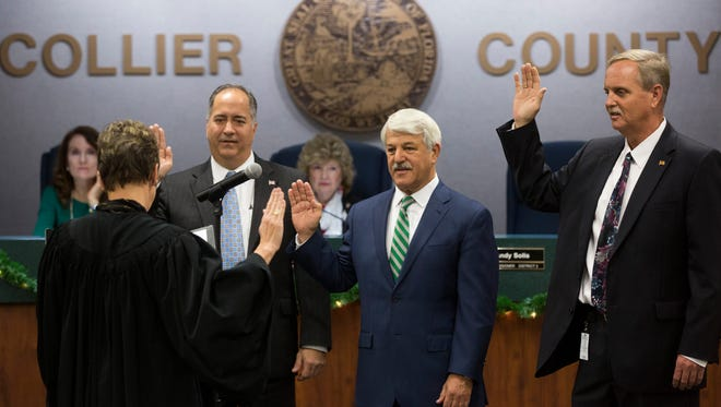 Collier Circuit Judge Christine Greider, from left, swears in newly elected District 2 Commissioner Andy Solis, District 3 Commissioner Burt Saunders and District 5 Commissioner William McDaniel to begin a Board of County Commissioners meeting Tuesday, Dec. 13, 2016, in Naples.