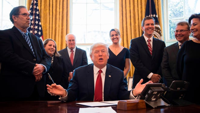 President Trump gestures after signing the Memorandum Regarding the Investigation Pursuant to Section 232(B) of the Trade Expansion Act in the Oval Office Thursday.