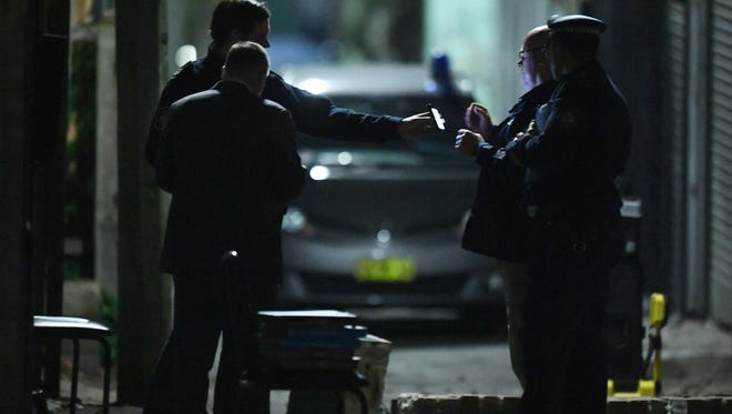 Australian police officers are seen during counter-terrorism raids in Surry Hills, Sydney, 29 July 2017.
