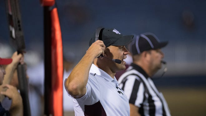 Henderson County Head Coach Josh Boston calls out instructions to his team at the Reitz Bowl Friday night.