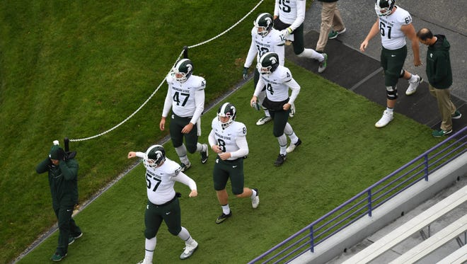 Michigan State Spartans players enter the field prior to a game against the Northwestern Wildcats at Ryan Field.