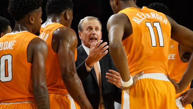 Tennessee coach Rick Barnes talks with his team during a timeout against Arkansas during the second half of an NCAA college basketball game Saturday, Dec. 30, 2017 in Fayetteville, Ark. (AP Photo/Michael Woods)