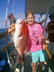 That's a big red snapper for a 78-pound girl.
