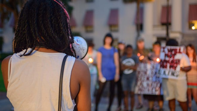 To commemorate the nine black victims of the Charleston Emanuel AME Church shooting, organizations including BLACC, Dream Defenders and Transgender Liberation Front held a candlelight vigil at the steps of the Capitol and rallied to end white supremacy.