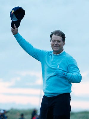 Tom Watson waves farewell to the fans from the Swilcan Bridge on the 18th hole of the British Open.