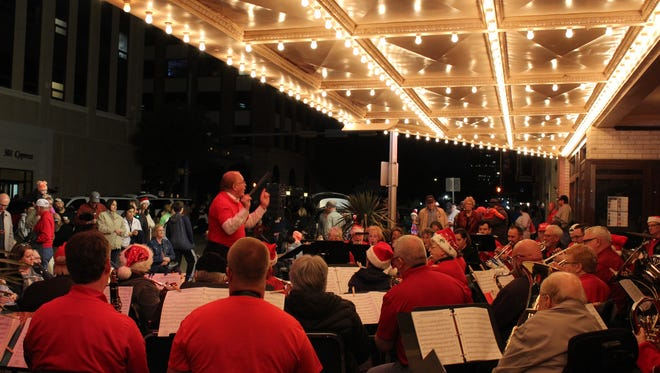 Joe Stephens directs the Abilene Community Band during its performance outside the Paramount Theatre during City Sidewalks.