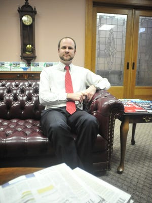 Brian Gernert sits in in the lobby of his law firm in Bucyrus.