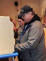 South Lyon voter Sean Penndorf brought his daughter, Ella, out to witness the voting process on election day.