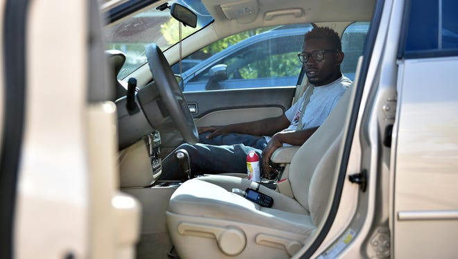 """Charles Foster sits where he sat June 18, 2016, the night Tupelo police Officer Tyler Cook shot his friend and teammate, Antwun """"Ronnie"""" Shumpert, 37, four times after Shumpert fled the car and hid in a Mississippi subdivision."""
