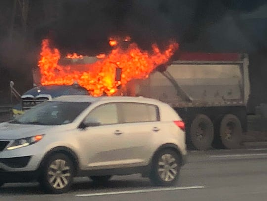 A dump truck is on fire along westbound Route 80 in