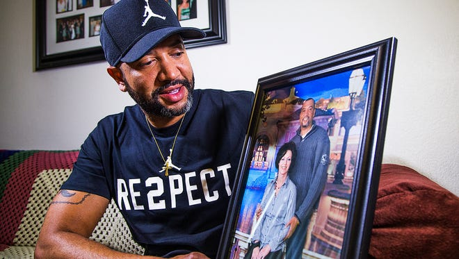 Eric Porter of Mesa holds a photo of himself and his wife, Amy, who died in October 2017. Porter had to fight to receive his wife's life insurance benefits after her death.